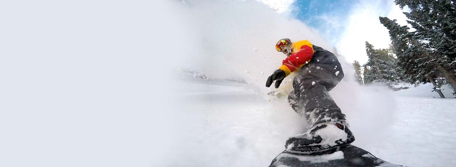 Jeremy Jensen surfing the snow without any bindings on his Grassroots Powsurfer.