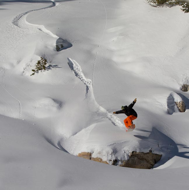 Jeremy Jensen Ollies his Grassroots Powsurfer in the Utah Backcountry.