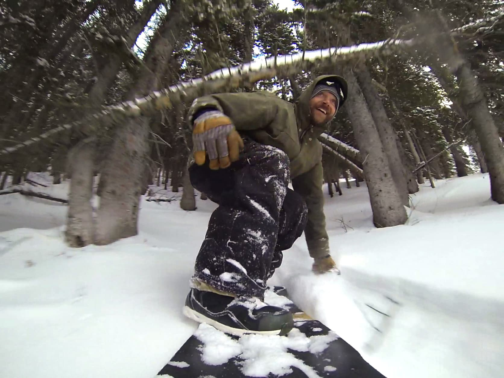 Brandon Saunders getting low on his grassroots powsurfer.