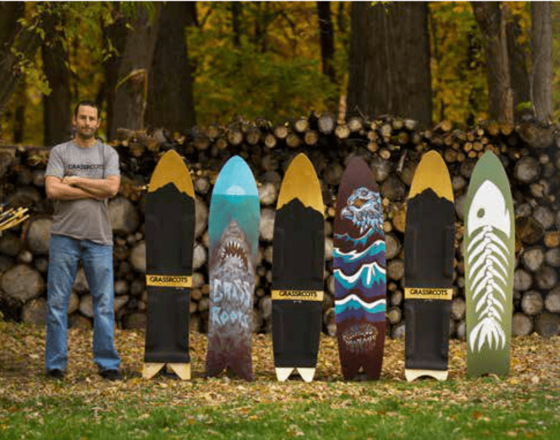 Jeremy Jensen stands with his creations. Jeremy is the founder of Grassroots Powdersurfing and the leading pioneer in the binding-free powsurfing and snowsurfing movement.